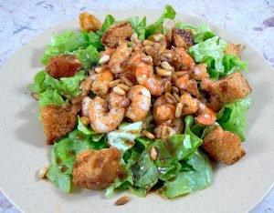 Salade tiède de scampis presentation